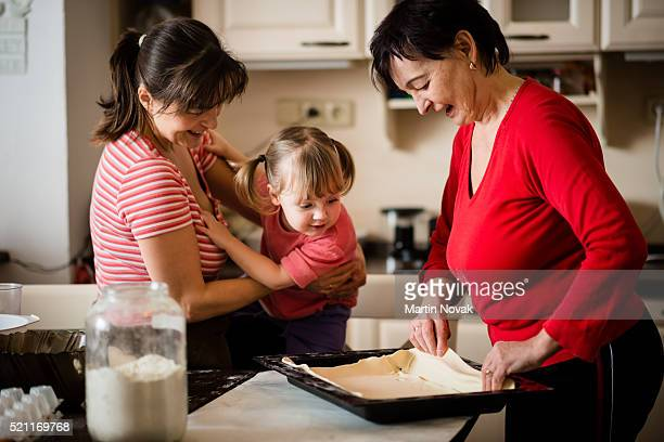 Three generations baking together