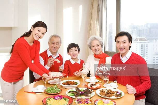 Three generations enjoying a Chinese New Year dinner together