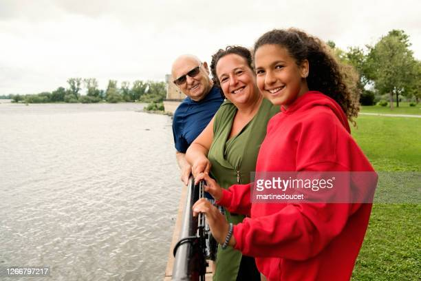 """three generations family portrait on riverside. - """"martine doucet"""" or martinedoucet stock pictures, royalty-free photos & images"""