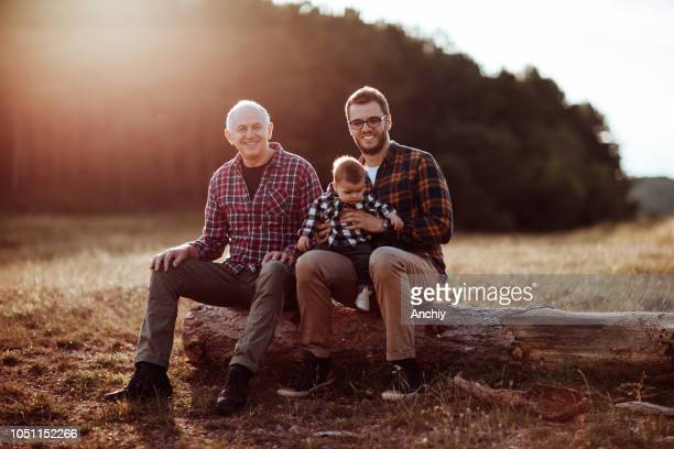 three generations male bonding in nature - checked pattern stock pictures, royalty-free photos & images