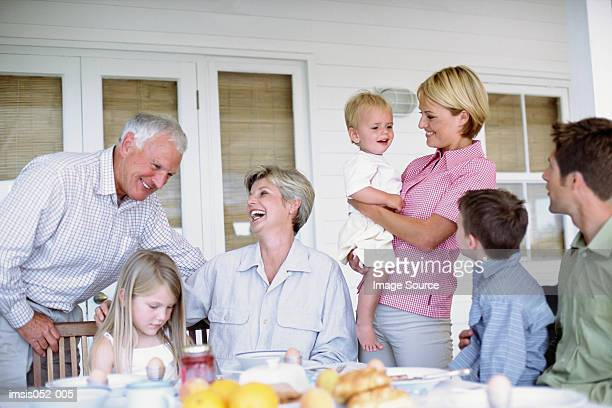 Three generations of a family eating together