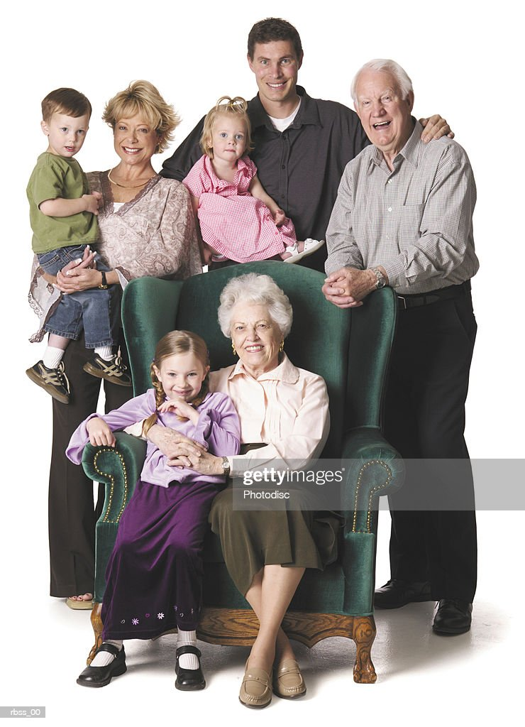 Three generations of a family pose happily for the camera. : Foto de stock