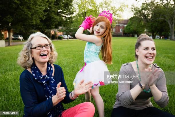 Three generations of Caucasian women relaxing in park