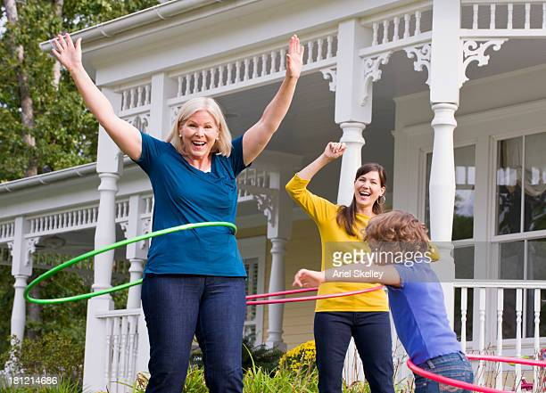 Three generations of Caucasian women with plastic hoops