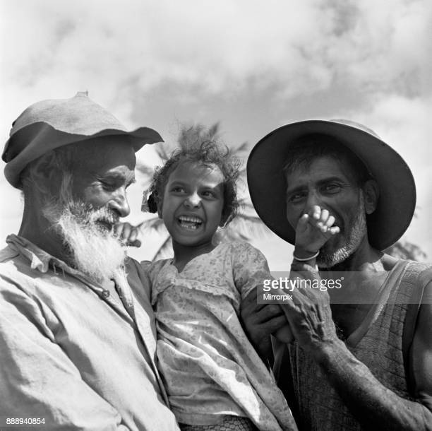 Three generations of descendants of indentured East Indian labourers brought to Trinidad in the mid 19th century to work in the sugar cane fields...