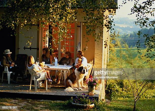 three generations of family eating meal in front of house - dog eats out girl stock pictures, royalty-free photos & images