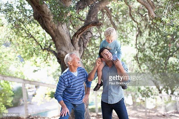 Three generations of men walking outdoors