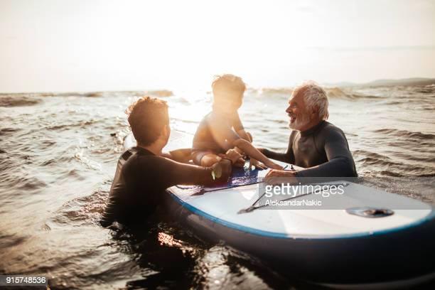Three generations of surfers