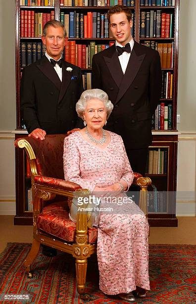 Three generations of the British Royal family Queen Elizabeth II sits in front of the Prince of Wales and Prince William as they pose for a...