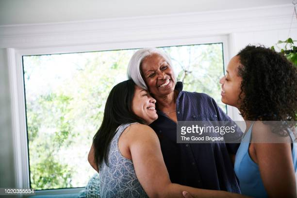 three generations of women bonding at home - teenager alter stock-fotos und bilder