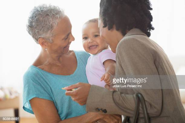 Three generations of women playing in living room