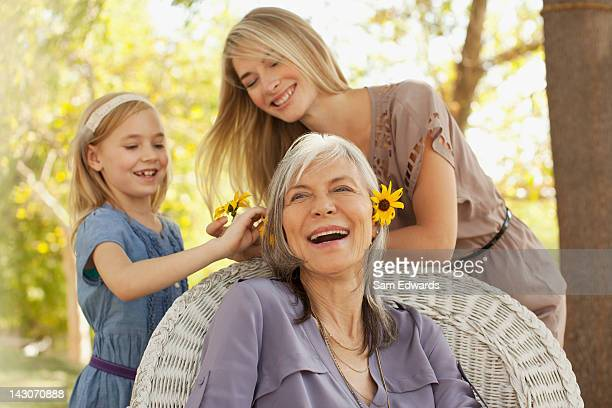 Three generations of women playing outdoors