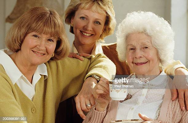 three generations of women, portrait - cardigan sweater stock pictures, royalty-free photos & images