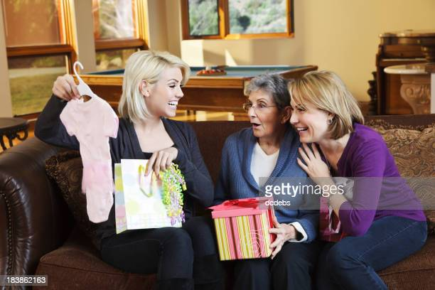 Three Generations of Women Sharing Baby Gifts