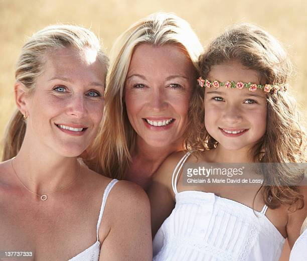 three generations of women smiling - niece stock photos and pictures