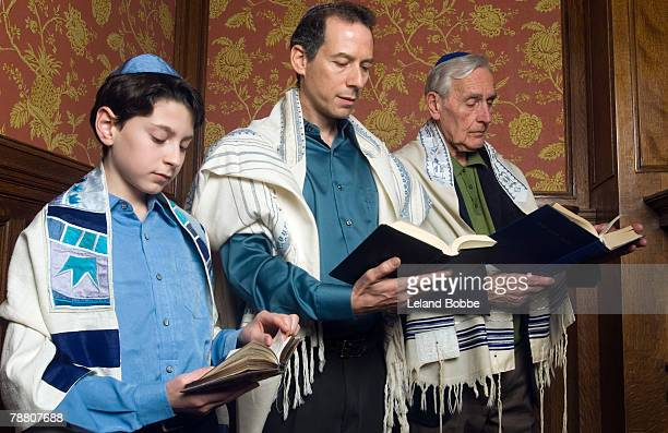three generations reading from the torah - torah stock photos and pictures