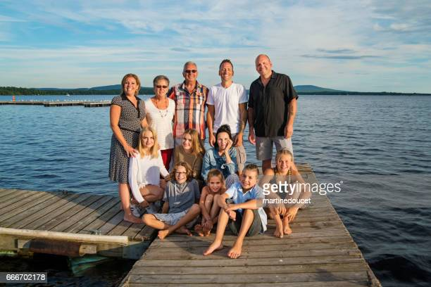 """three generations real family portrait outdoors in summer. - """"martine doucet"""" or martinedoucet stock pictures, royalty-free photos & images"""