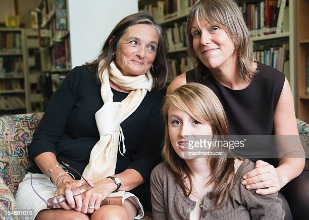Three generations women in a library.