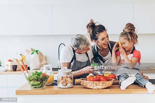 three generations women in the kitchen - beautiful granny stock-fotos und bilder