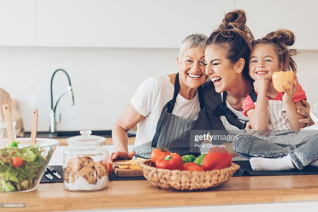 Three generations women laughing in the kitchen : Stock-Foto