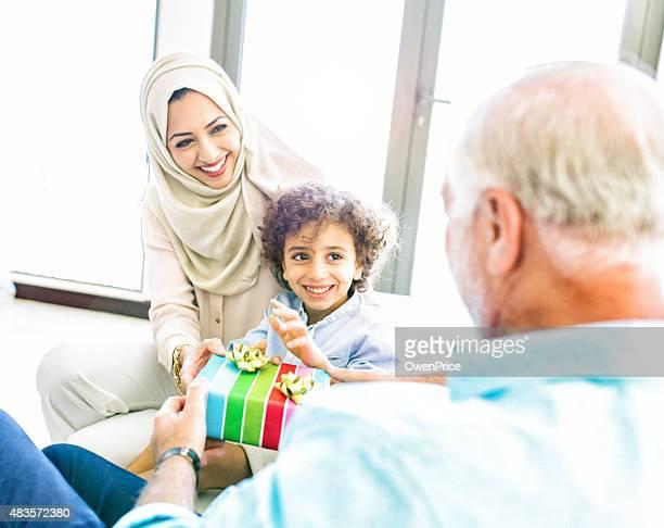 Three Genration Arabic family celebrating a childs birthday