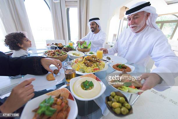 three genration arabic family enjoying lunch - ramadan stock pictures, royalty-free photos & images