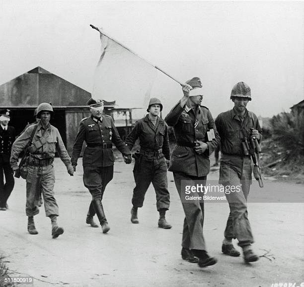 Three German officers have been taken prisoner and are being led back after talks with American officers near Brest, France, 20th September 1944. The...