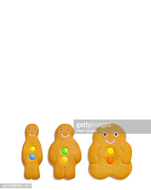 Three gingerbread cookies on white background, close-up