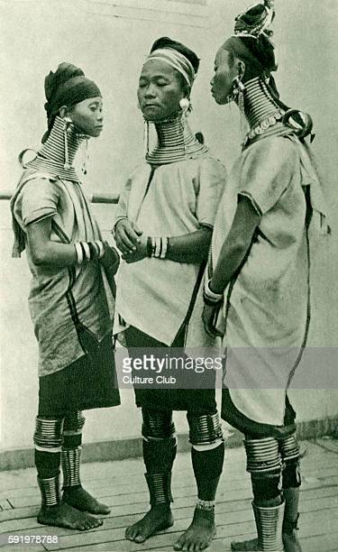 Three giraffe necked women of Padaung, Burma. Caption reads - 'When little more than babies, females of this tribe are made to wear five brass rings...