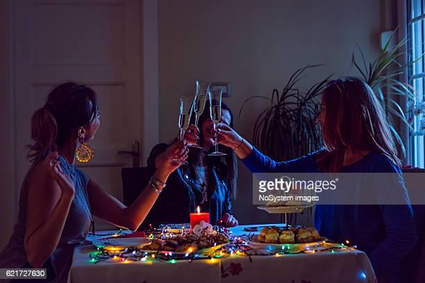 Three girl friends celebrating