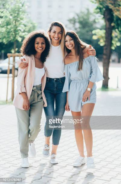 three girlfriends looking happy together - girlfriend stock pictures, royalty-free photos & images