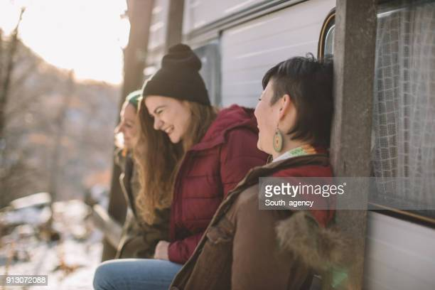 Three girlfriends smiling