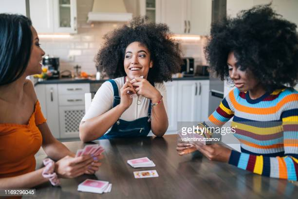 three girls at home playing cards - poker card game stock pictures, royalty-free photos & images