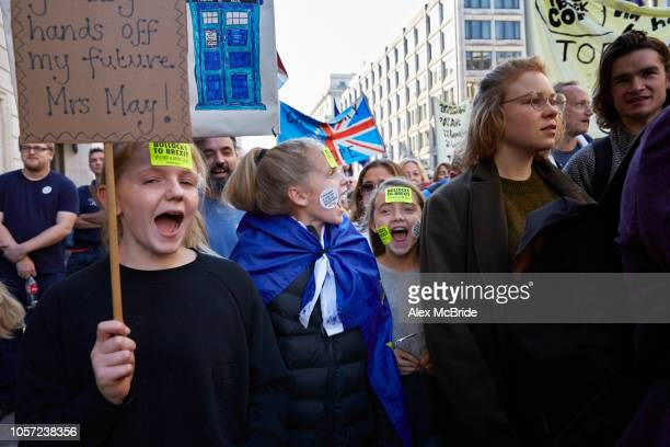Three girls chant slogans in support of the final say march outside The Ritz Hotel on October 20 2018 in London England More than one hundred...