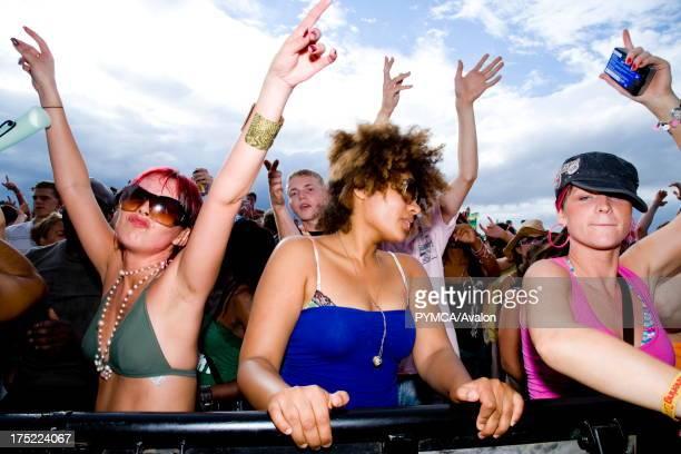 Three girls dancing Global Gathering festival Long Marston Airfield Stoke on Trent UK 28/29 July 2006