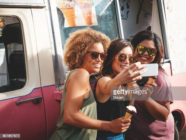 three girls eating ice creams near the ice cream truck in australia - fat asian woman stock pictures, royalty-free photos & images