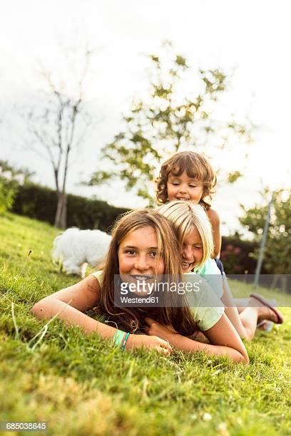 Three girls having fun together on a meadow