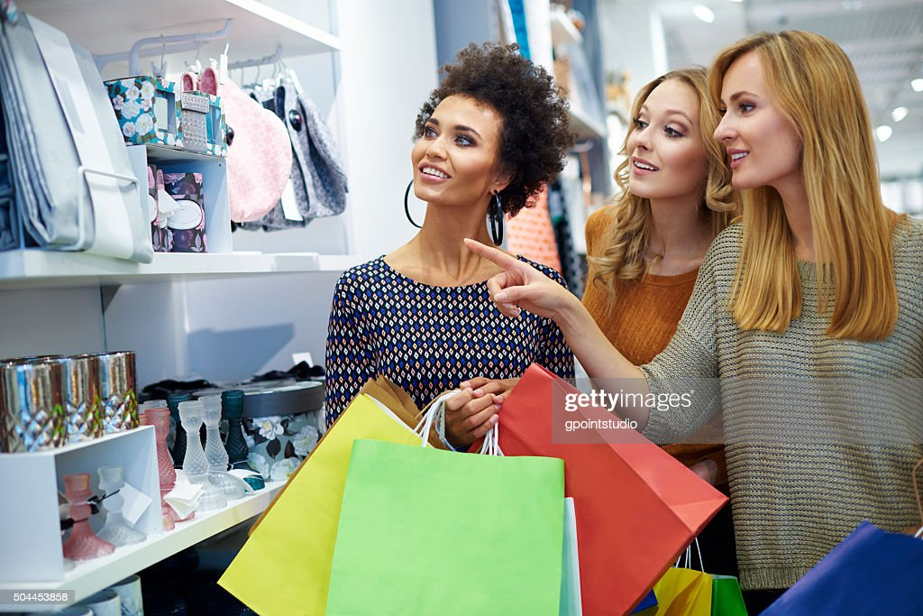 Three girls in the shop : Stock Photo