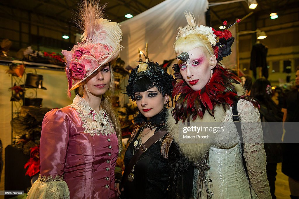 Three girls in Victorian clothing pose for pictures at the Agra festival area on the first day of the annual Wave-Gotik Treffen, or Wave and Goth Festival, on May 17, 2013 in Leipzig, Germany. The four-day festival, in which elaborate fashion is a must, brings together over 20,000 Wave, Goth and steam punk enthusiasts from all over the world for concerts, readings, films, a Middle Ages market and workshops.