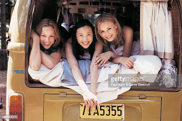 Three Girls Lying in the back of a Camping Van