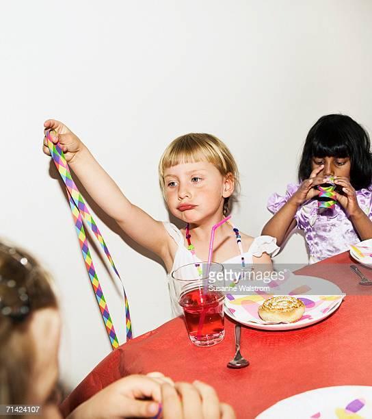 Three girls on a children's party.