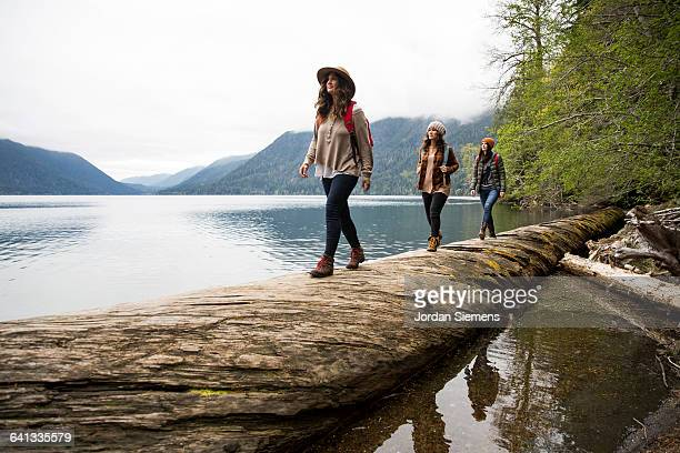 three girls on a day hike. - hiking stock pictures, royalty-free photos & images