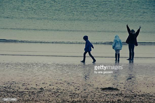 Three girls on rainy beach