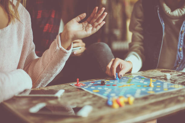 three girls playing game man do not angry. close up. - board game stock pictures, royalty-free photos & images