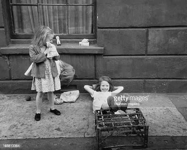 Three girls playing in a London street August 1954 Original publication Picture Post 7230 Children Of The Streets pub 7th August 1954