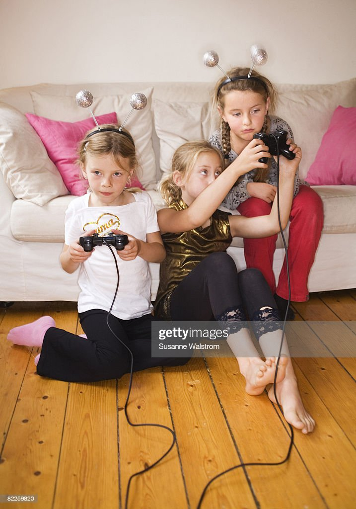Three girls playing video game Sweden. : Stock Photo