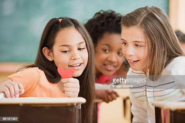 Three girls reading a note