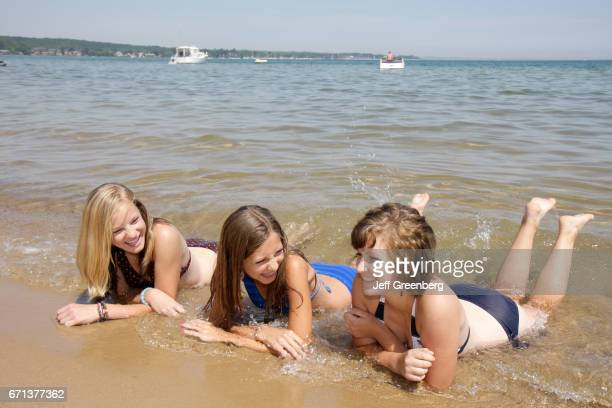 Three girls relaxing in the water at Clinch Park
