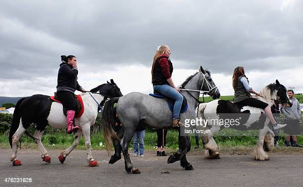 Three girls ride their horses along Flashing Lane during the Appleby Horse Fair on June 7 2015 in Appleby England The fair is an annual gathering for...