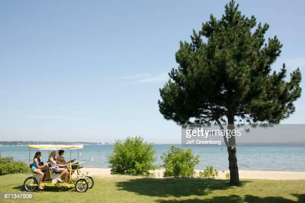 Three girls riding a quadracycle at Clinch Park.
